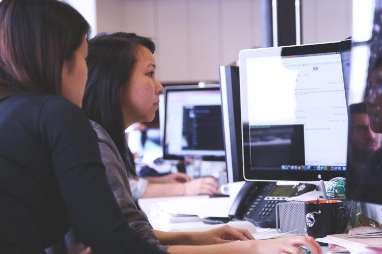 Forecasters working together at desk