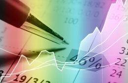 Image of a pen above a financial graph