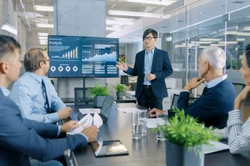 Image of man presenting data to team