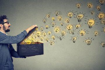 Image of man opening box of light bulbs