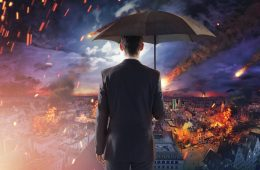 Image of man looking out across burning city