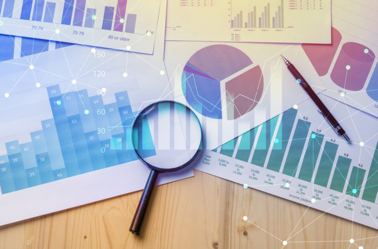 Image of graphs and charts on a desk