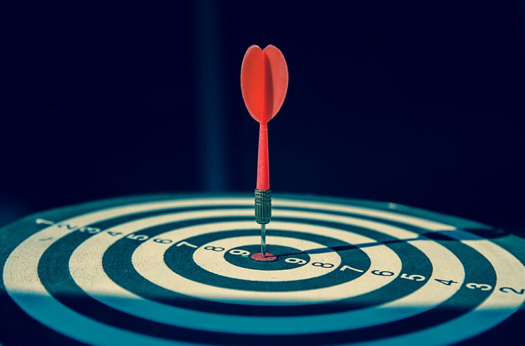 Forecast accuracy concept with dartboard