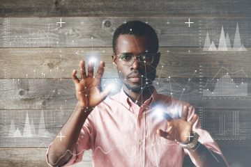 man in shirt surrounded by data science imagery